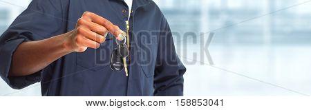 Car mechanic with key.
