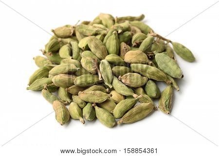 Heap of cardamom pods isolated on white