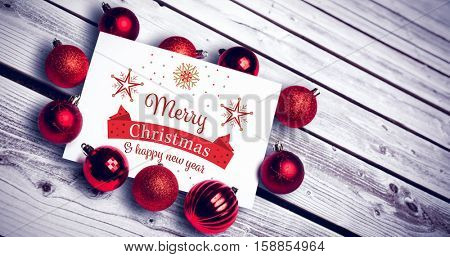 Christmas card against overhead of wooden planks