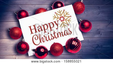 Christmas card against bleached wooden planks background
