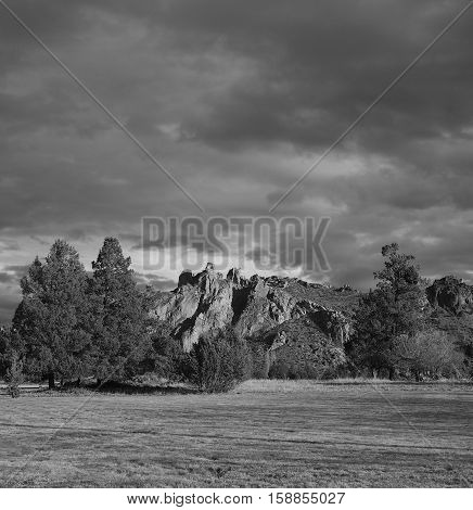Smith Rocks in Central Oregon is illuminated on a stormy Central Oregon day.
