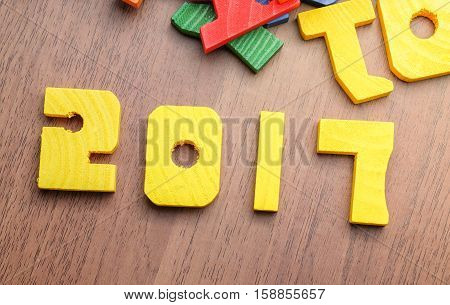 2017 New Year Number Yellow Color Toy On Wood Table With Other Font Toy, Holiday Concept