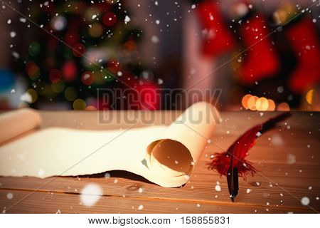 Snow falling against old blank scroll paper and quill