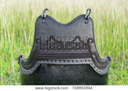 Used and Dirty Kendo Body Armour Protective or DO in grass field.