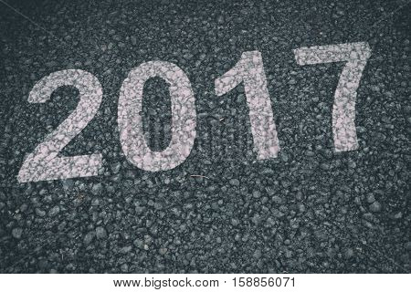 Happy New Year 2017 against black road