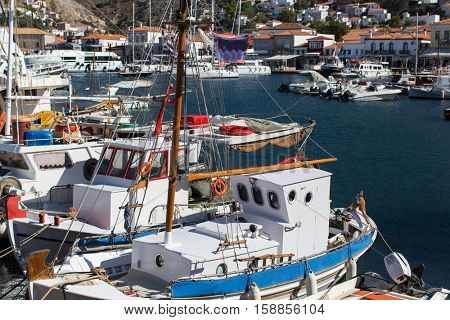 Old fishing boats in the harbour of Hydra island, Aegean sea, Greece.