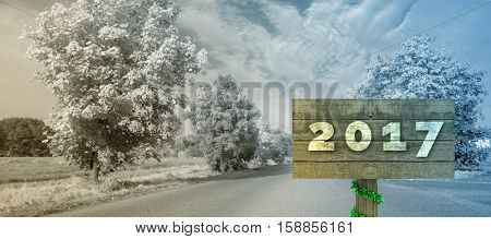Digital image of new year 2017 against warped road