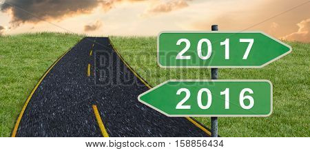 Digital image of new year 2017 against road on grass