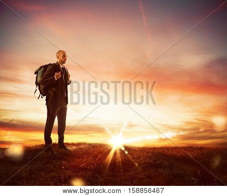 Businessman with explorer backpack looking for new business