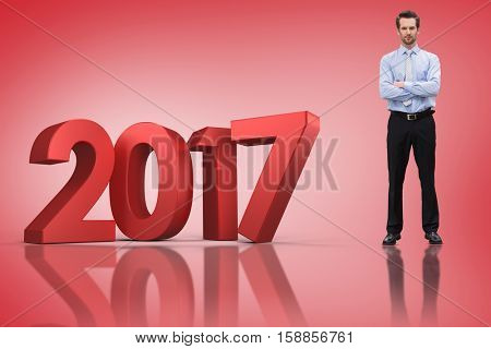 Serious manager with arms crossed against red vignette with 3D new year