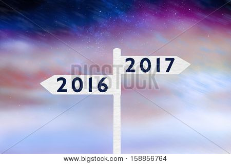 Digital image of new year 2017 against aurora night sky in purple