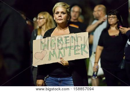 November 12 2016 - Long Beach United Against Trump - March in Unity & Peace. Woman holding sign,