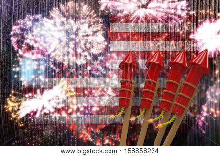 3D Rockets for fireworks against colourful fireworks exploding on black background