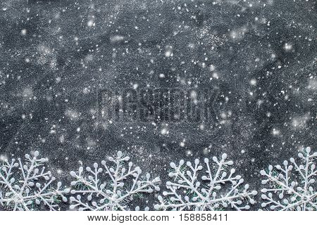 Snowflakes on a black chalkboard. Christmas background