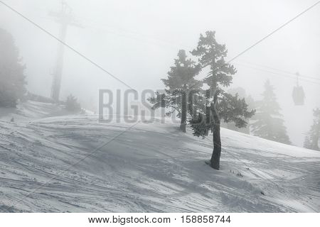 Ski slopes in thick fog, low visibility