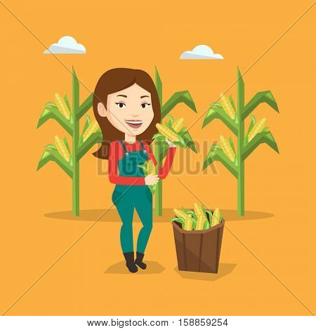 Female caucasian farmer holding a corn cob on the background of corn field. Farmer collecting corn. Happy smiling farmer standing near basket with corn. Vector flatdesign illustration. Square layout.