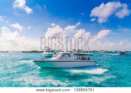 MALE, MALDIVES - October 04 :  Boats at the harbor next to Ibrahim Nasir International Airport in Male, Maldives.