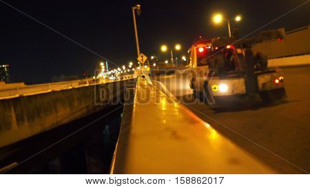 Forklift trucks service on the expressway Ekamai - Ramindra in Bangkok the city of Thailand photo at nightimes focus celect at center around are blur use background concept.