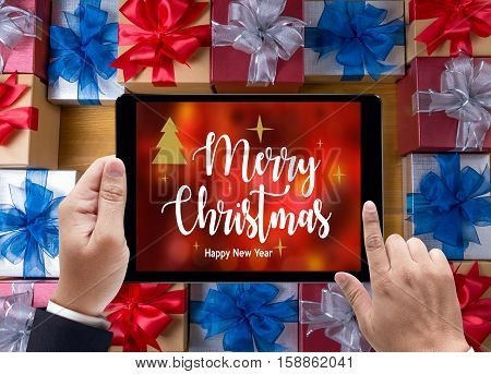 Box Gift  And Small Gift Wrapped , Presents And Christmas ,  Man Using Ipad And Gifts, Celebrations