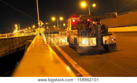 Forklift trucks service on the expressway Ekamai - Ram Indra in Bangkok the city of Thailand photo at nightimes.