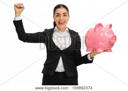 Cheerful businesswoman holding a piggybank and gesturing with her hand isolated on white background