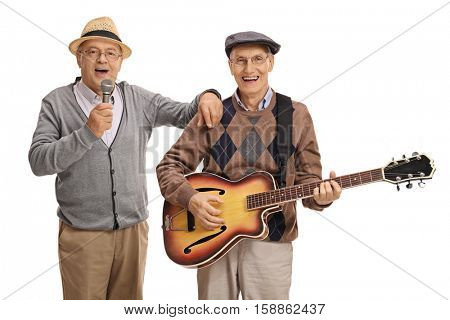 Elderly man singing on a microphone and another elderly man playing a guitar isolated on white background
