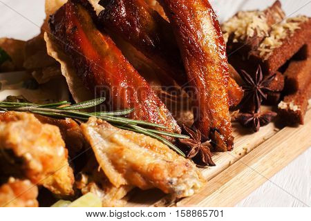Close-up of smoked delicious snacks. Tasty golden appetizing assortment of junk food. Fat, american cuisine concept