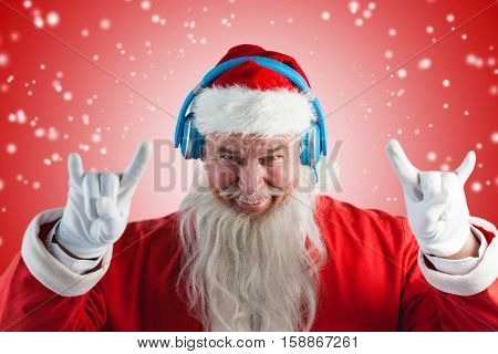 Portrait of Santa Claus gesturing against white light dots on red