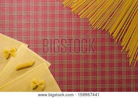 Lasagne sheets, spaghetti and different pasta background. Flat lay. Top view. Close up. Food background concept.