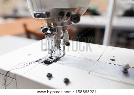 Sewing machine head close-up free space. Important part of garment equipment. Shuttle a needle detail photo. Seamstress tool, clothes making, tailor workshop concept