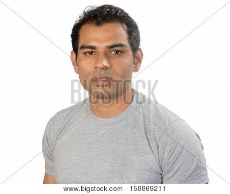 A young Indian South Asian man looking to camera - isolated on white studio shot