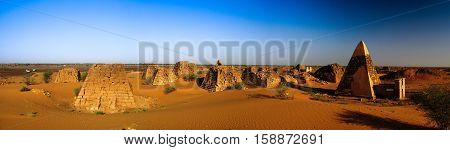 Panorama of Meroe pyramids in the desert at sunset Sudan