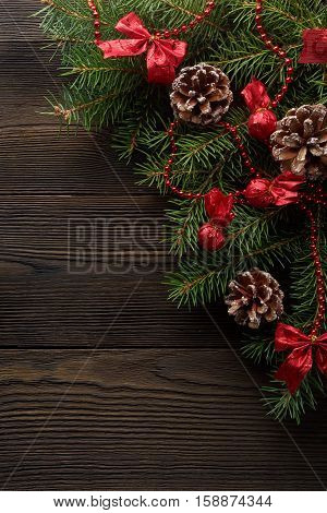 Christmas wooden background with Christmas tree and red decoration. Christmas background cardboard box with a red bow. A Christmas gift. Gift on Valentine's Day. Christmas white cardboard box with a red bow
