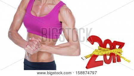 Female bodybuilder flexing in sports bra and shorts against digital image of 3D new year with tape measure