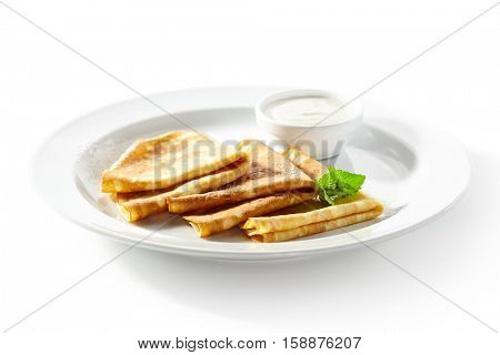 Crepes with Sour Cream and Mint Leaf
