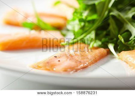 Fresh Salmon Carpaccio with Rocket and Pesto Sauce