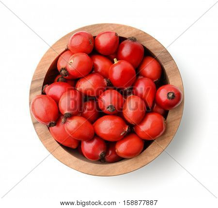 Top view of rose hips in bowl isolated on white