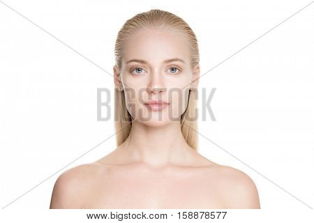Portrait Of A Beautiful Young Blond Woman With Long Slicked Hair. Isolated On White Background