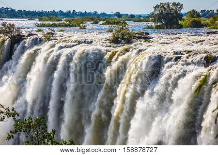 The famous Victoria Falls on the Zambezi River in South Africa. After the rainy season, the waterfall most high water