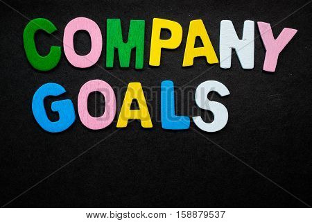 """Colorful wooden letters forming the phrase """"company goals"""""""