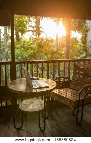 Freelancer working place in wooden Balinese house with a beautiful sunlight