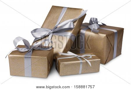 Group of gift boxes wrapped with golden paper and silver satin ribbon, isolated on white background. Modern present for any holiday, christmas, valentine or birthday