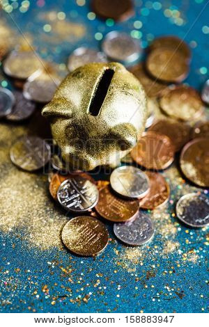 piggy bank and pound GBP coins