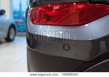 Closeup photograph of parking sensors on a modern car