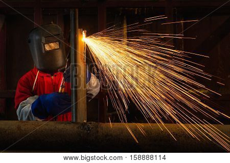 Worker welding construction by MIG welding Worker welding the steel part by manual