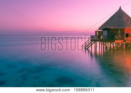 Fantastic color of sunset on a tropical island. Relax evening in the Maldives. Bleach Bypass effect