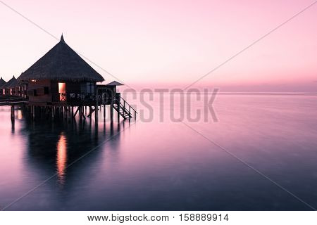 Overwater Bungalow. Relax evening on a tropical island. Maldives.
