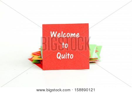 picture of a red note paper with text welcome to Quito