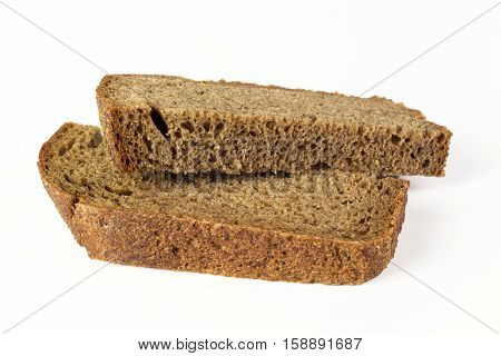 two slices of brown bread on a white background