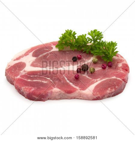 Raw pork neck chop meat with parsley herb leaves and peppercorn spices garnish isolated on white background cutout